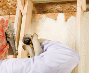 Spray foam insulation being installed by a certified professional in New York