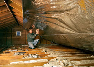 A radiant barrier installed in a Monsey attic